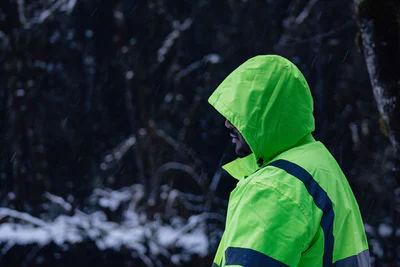 Man wearing bright reflective clothing